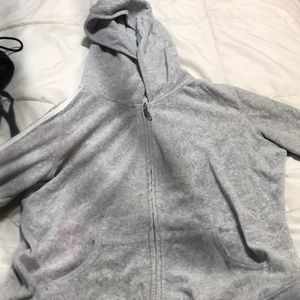 Grey hoodie with white stripes on sleeves